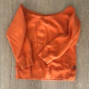TNA off-the-shoulder orange sweatshirt